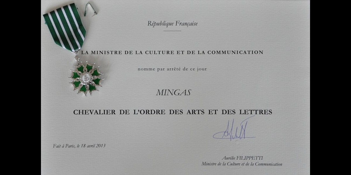December, 2013:  Mingas receiving insignia as  <i>'Chevalier dans l'Ordre National des Arts et des Lettres'</i> (photo by ps)